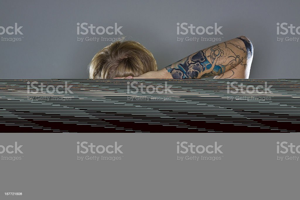A man hiding a CGI log on a gray background stock photo