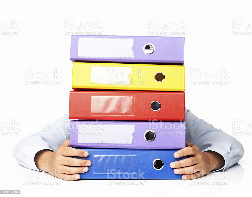 Man Hiding Behind Pile Of Folders - Isolated royalty-free stock photo
