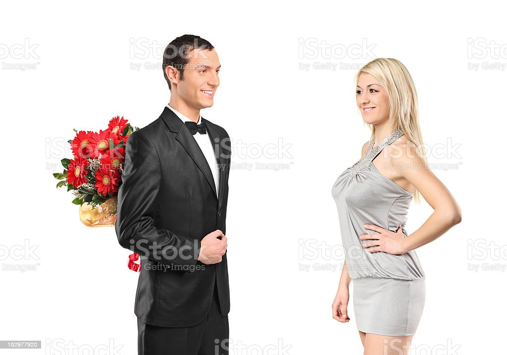 Man hiding bouquet of flowers and woman royalty-free stock photo