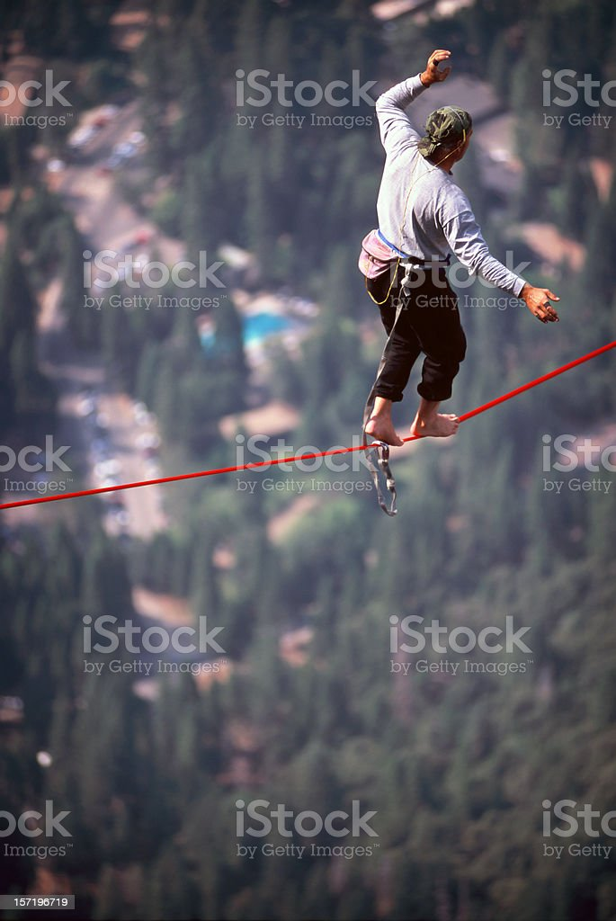 Man High Lining stock photo