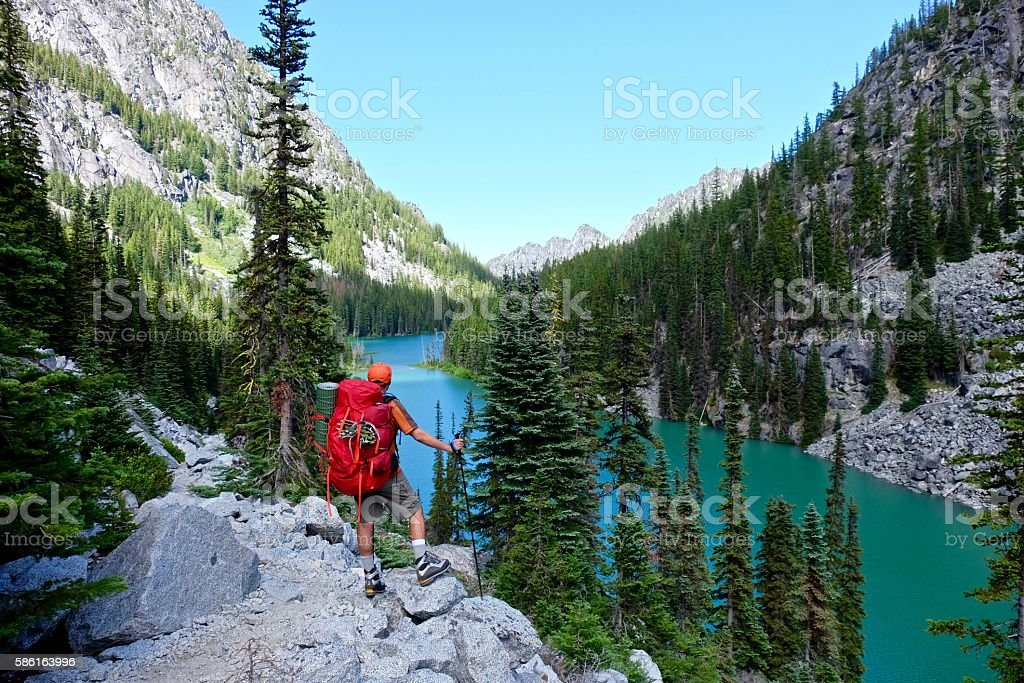 Man hiker by lake. stock photo
