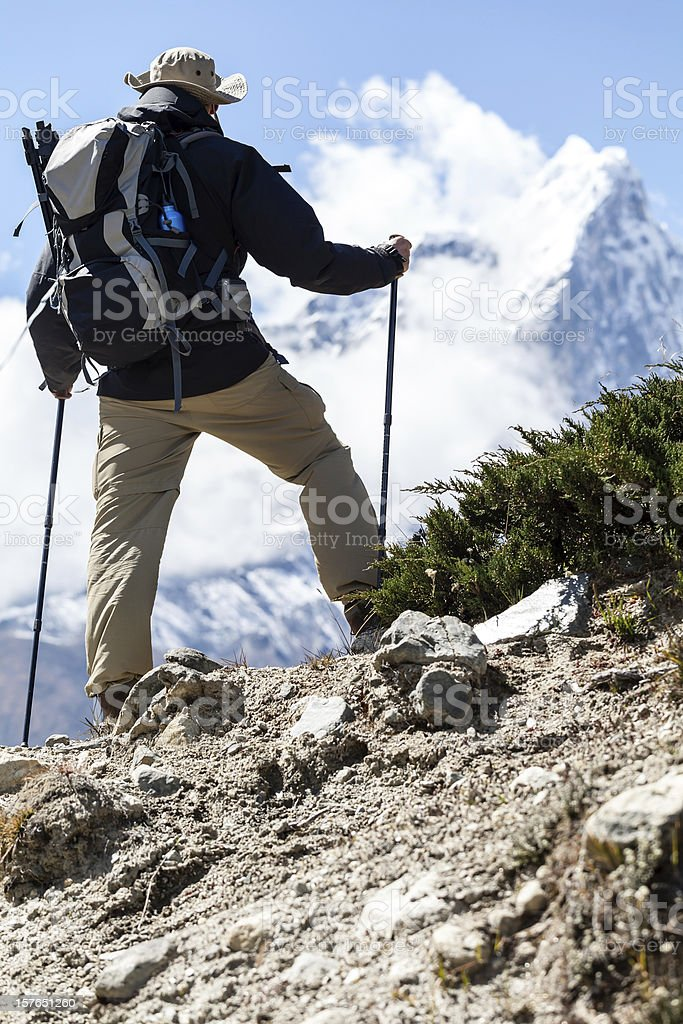 Man hiker hiking in mountains royalty-free stock photo