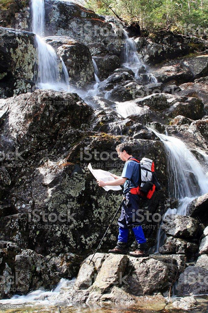 Man Hiker Looking at Map in Waterfalls royalty-free stock photo