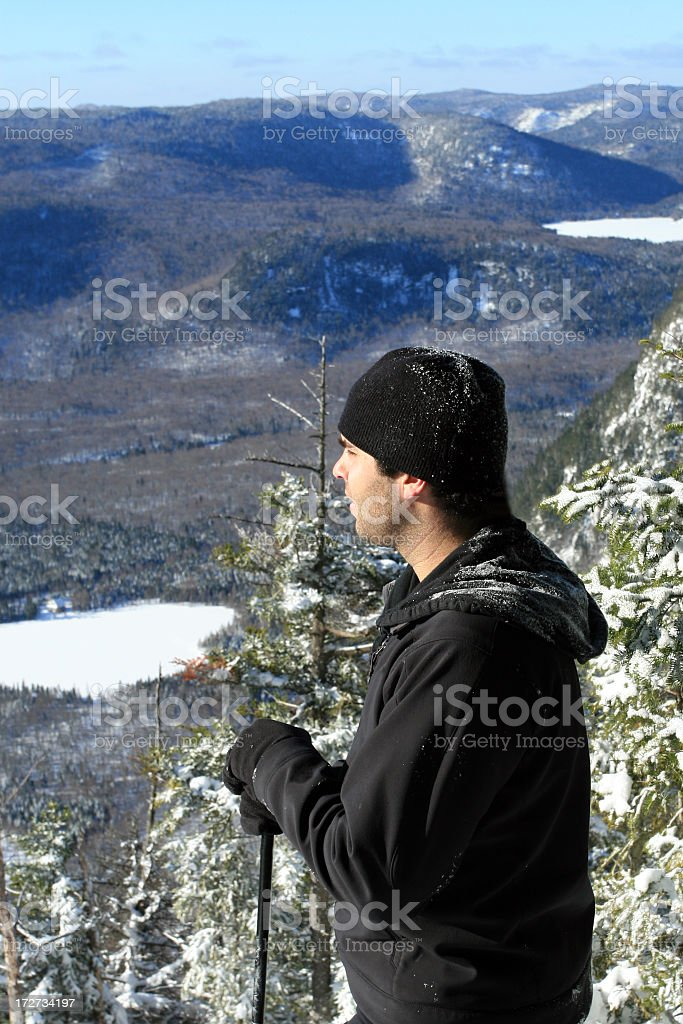 Man Hiker looking at the view in Winter royalty-free stock photo