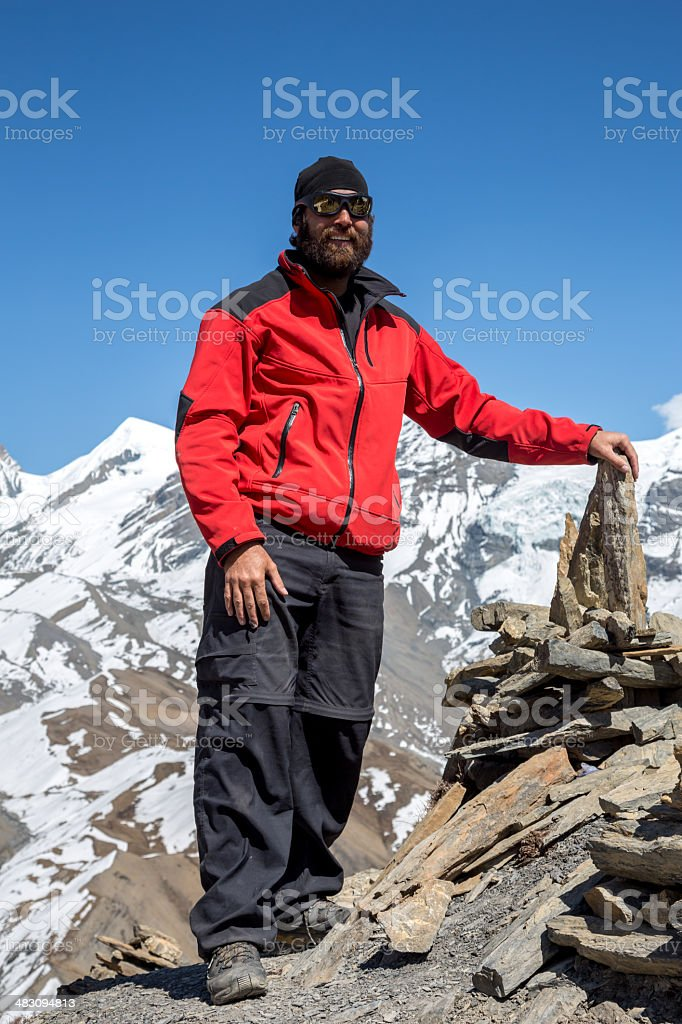 Man Hiker on Mountain Summit, Annapurna Trek, Nepal royalty-free stock photo