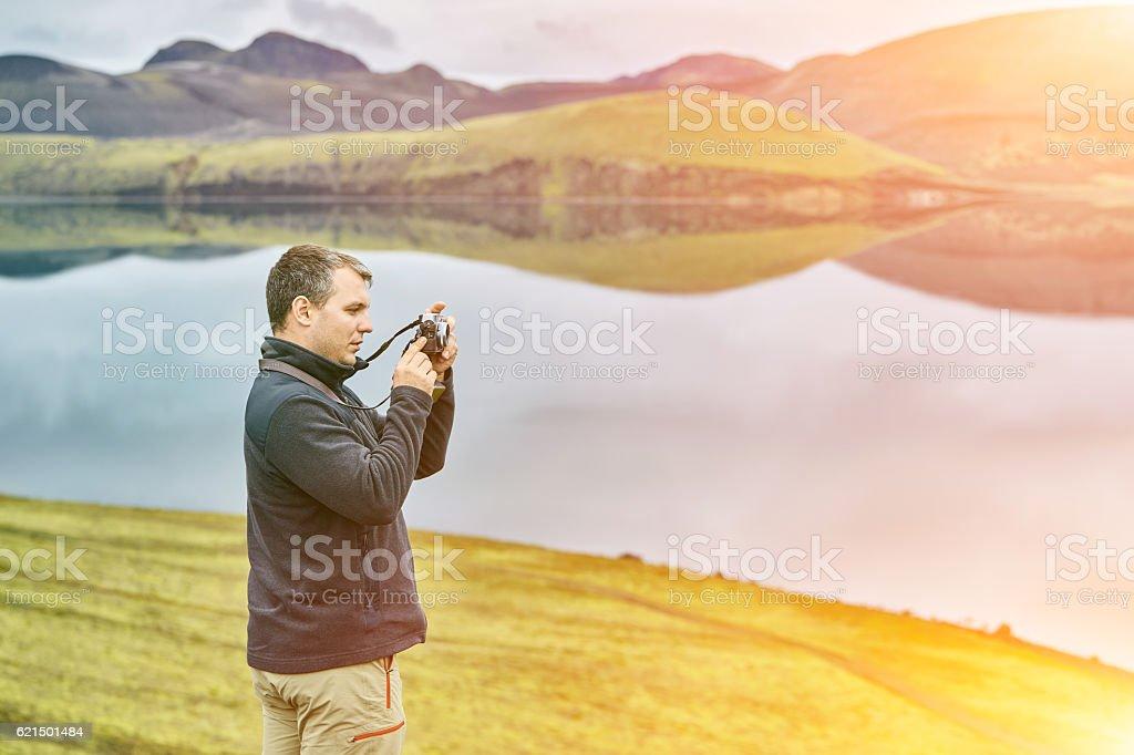 man hiker photographer stock photo