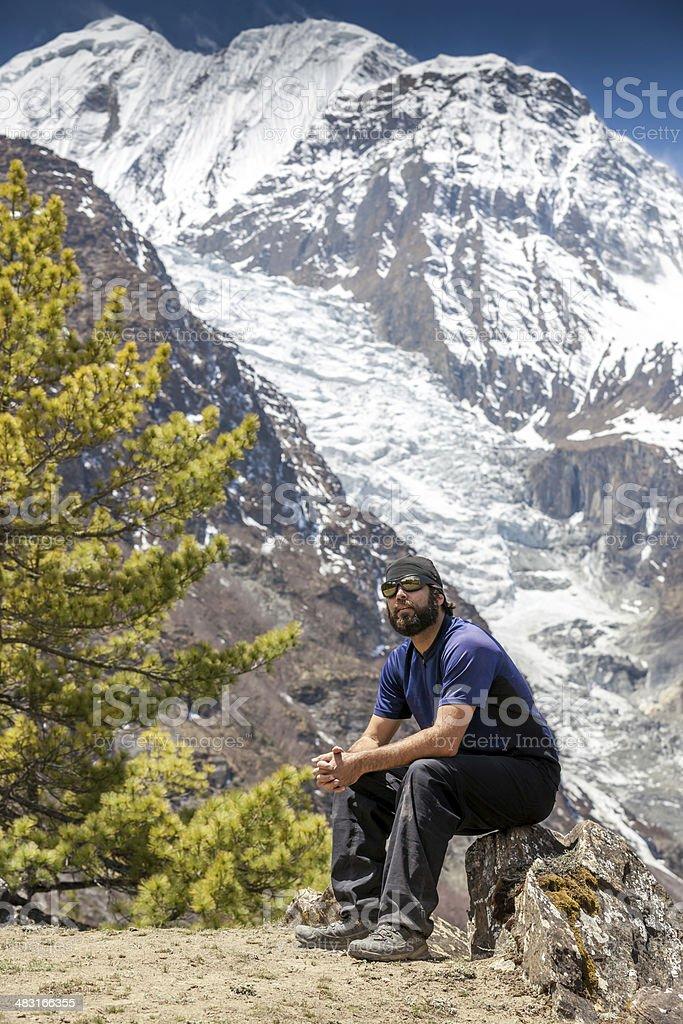 Man Hiker Sitting and Resting, Annapurna Trek, Nepal royalty-free stock photo