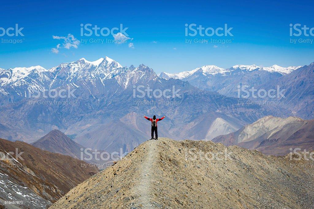 Man hiker with arms raised Annapurna trek, Nepal stock photo