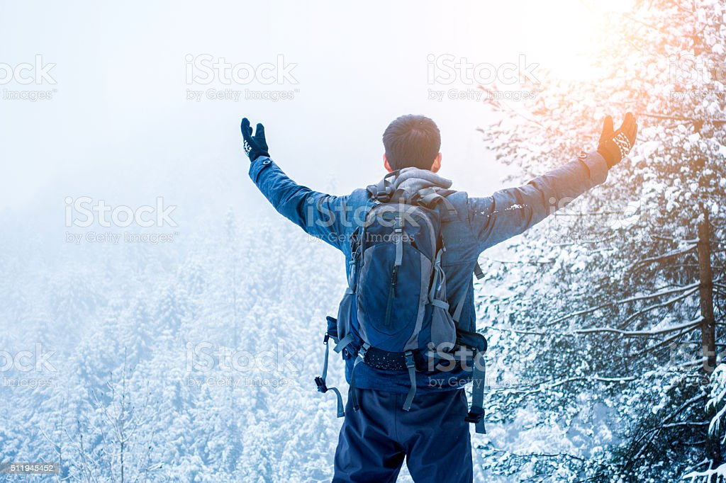 Man Hiker with Arms Raised stock photo