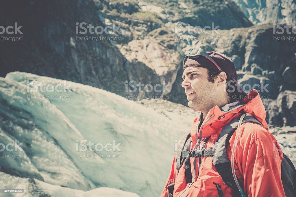 Man Hiker with Mountain and Glacier Background stock photo