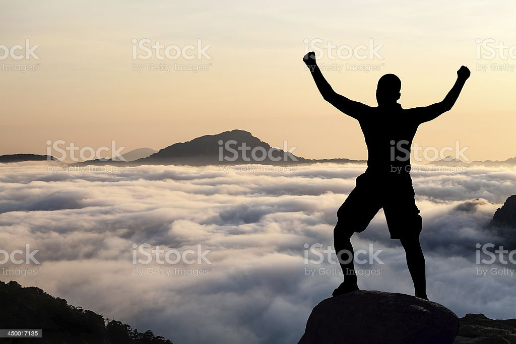 Man hiking climbing silhouette in mountains royalty-free stock photo