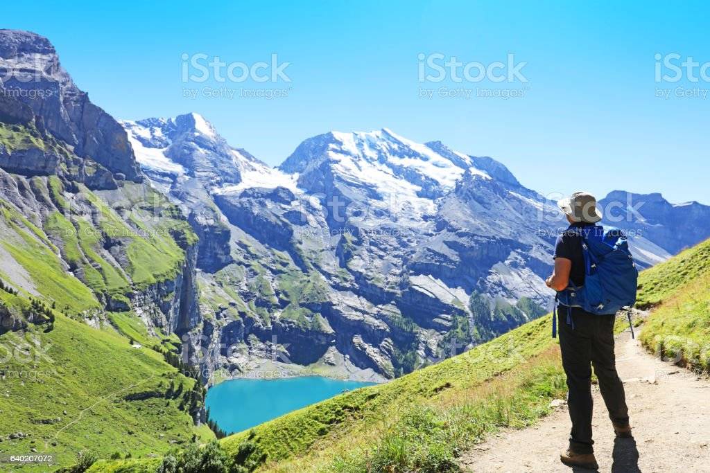 Man Hiking in the Mountains in Switzerland stock photo