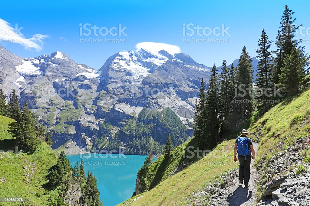 Man Hiking in the Swiss Mountains in Summer stock photo