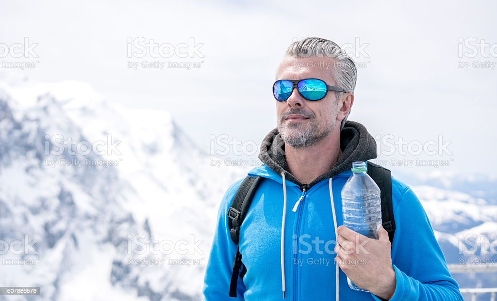 Man hiking in the winter stock photo