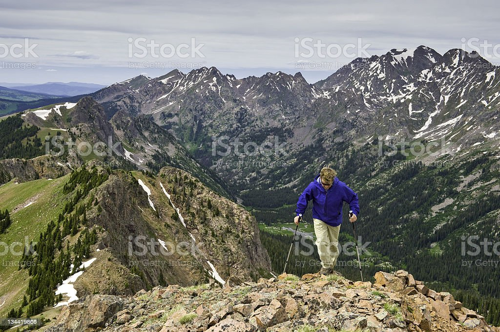 Man Hiking on Scenic Ridge High in the Mountains royalty-free stock photo