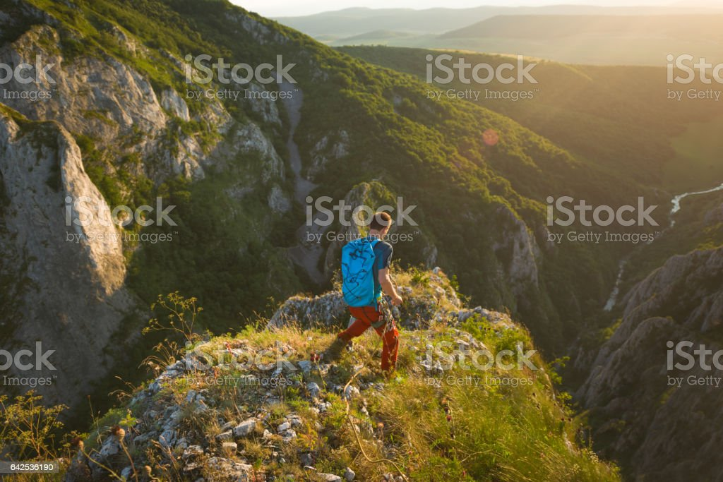 Man hiking outdoor in nature during sunset stock photo