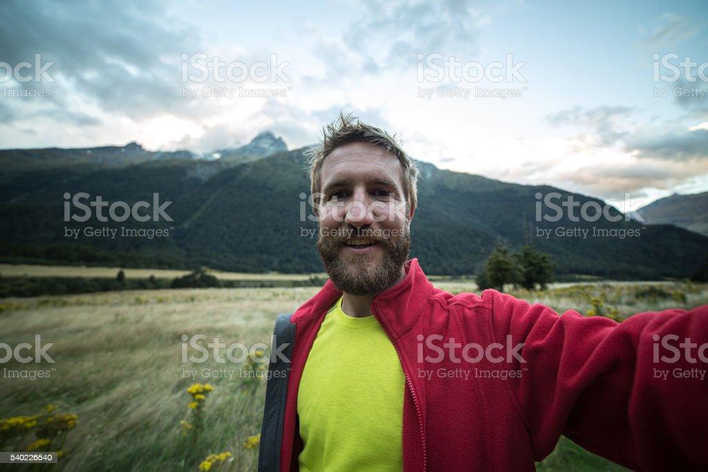 Man hiking takes selfie portrait stock photo