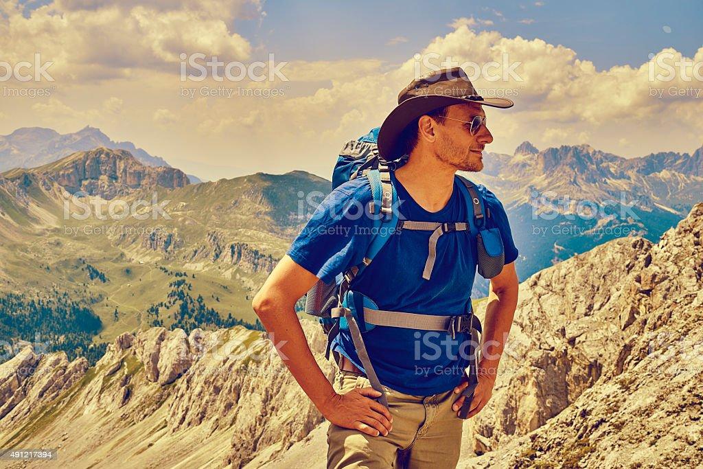 Man hiking the Italian Dolomites stock photo