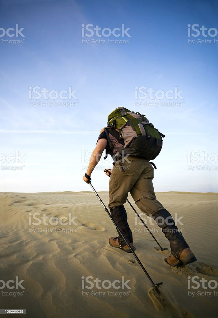 Man Hiking Through The Desert royalty-free stock photo