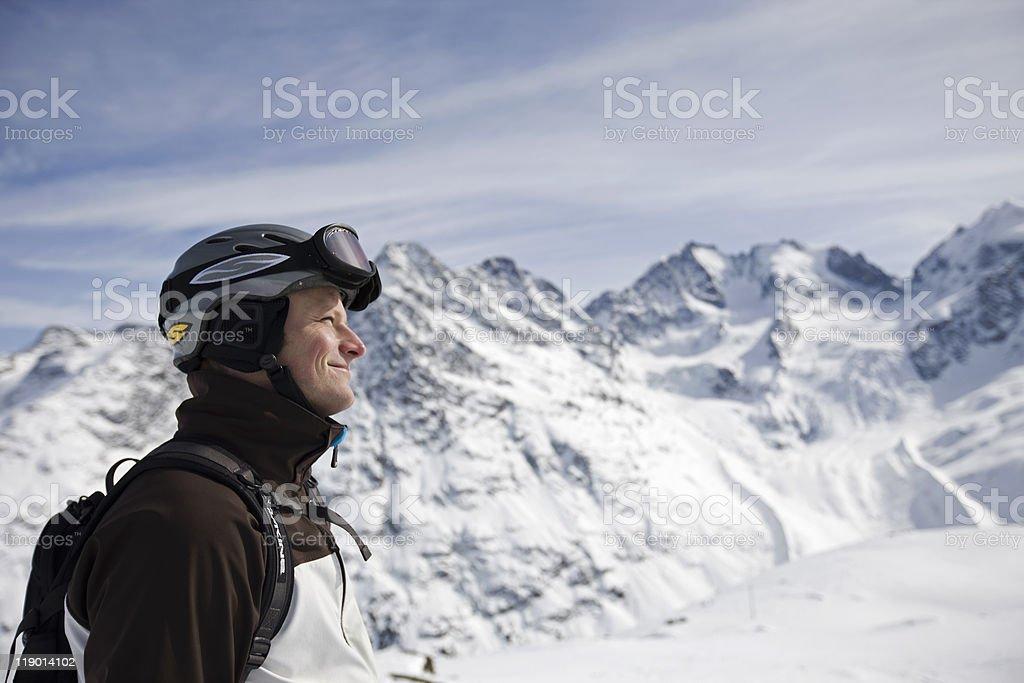Man hiking up snowy mountain stock photo