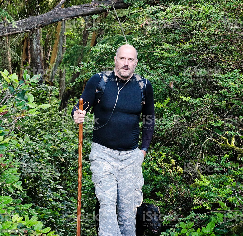 Man Hiking Using Oxygen Therapy stock photo