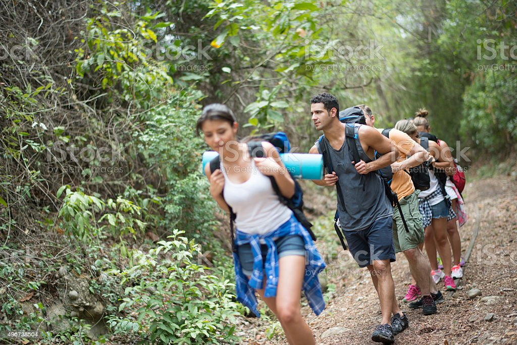 Man hiking with a group of friends stock photo