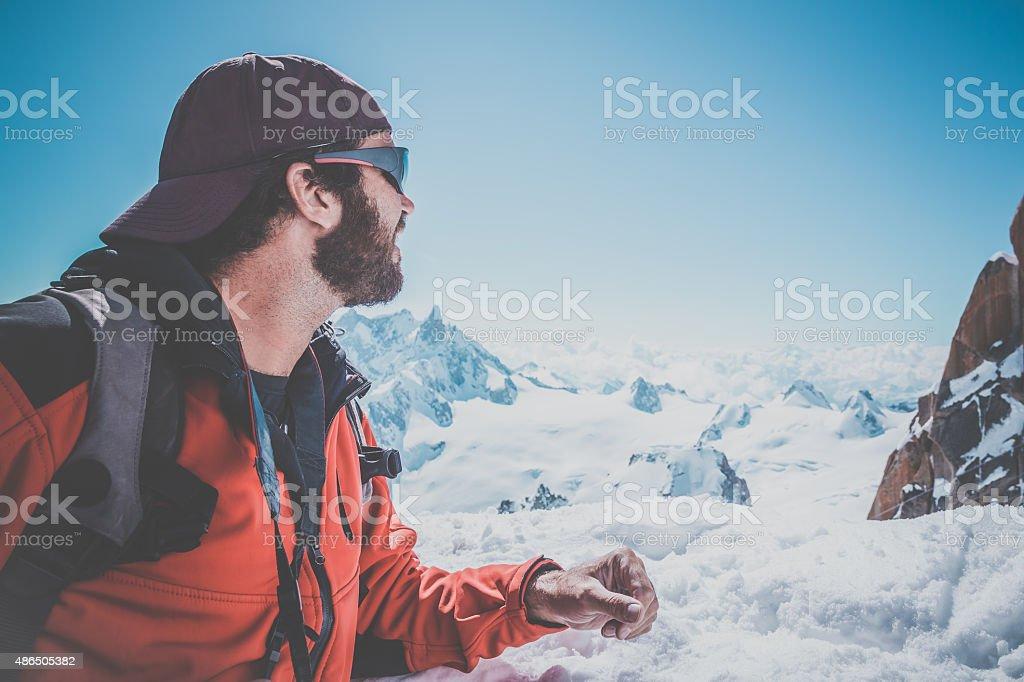 Man Hiking with Mont Blanc Massif Background, Chamonix, France stock photo