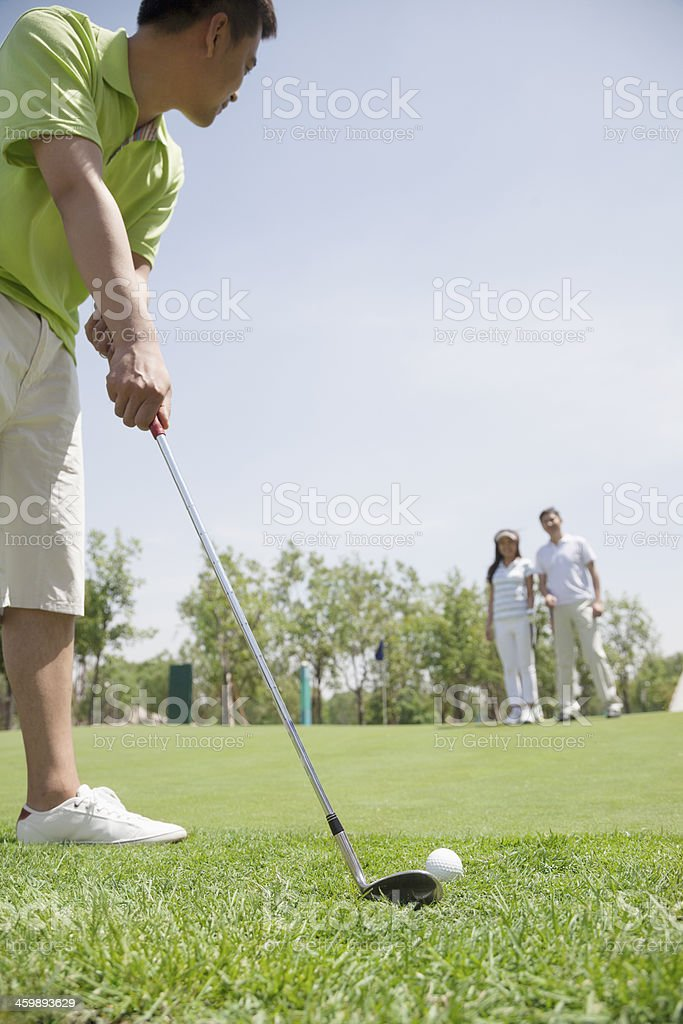 Man hitting a ball on the golf course royalty-free stock photo