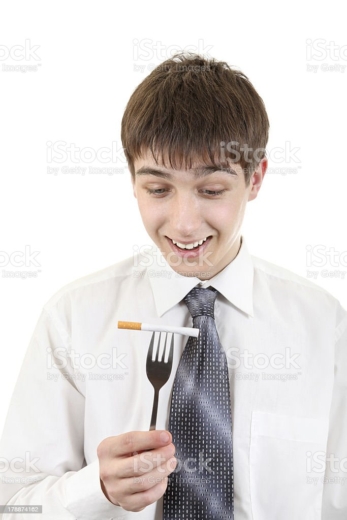 Man Hold Cigarette on the Fork royalty-free stock photo