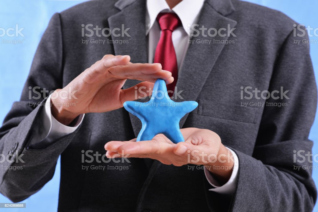 man hold star stock photo