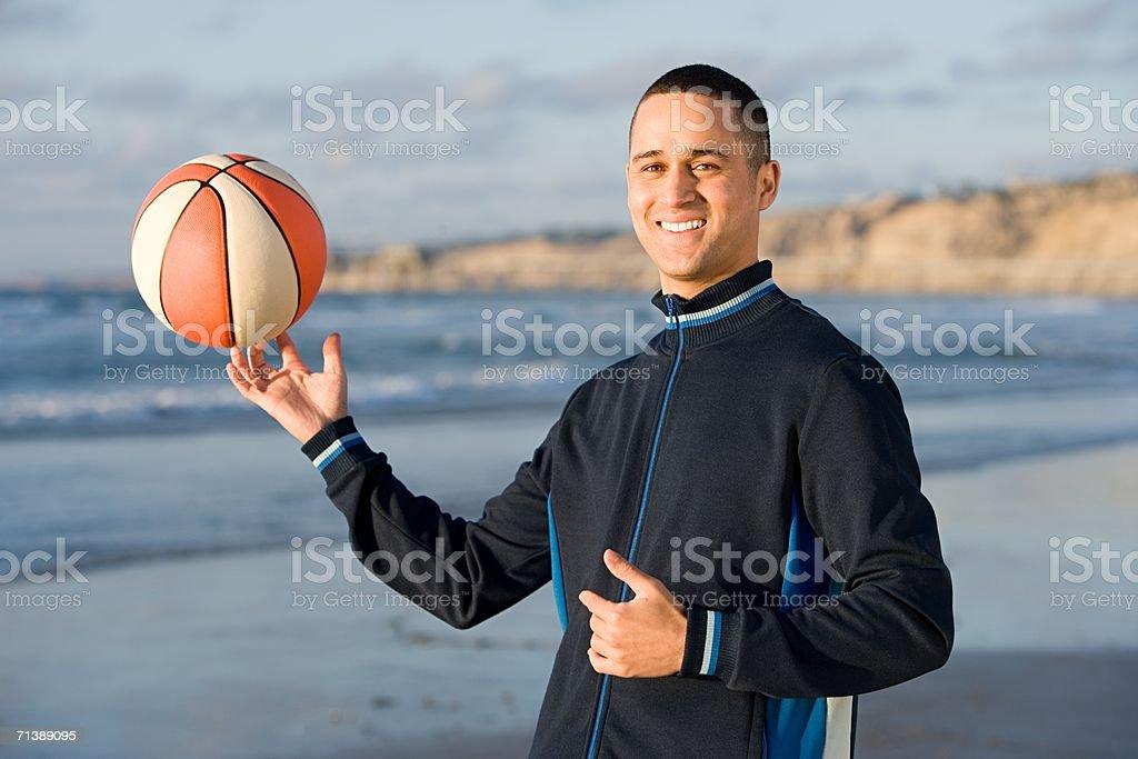 Man holding a basketball stock photo