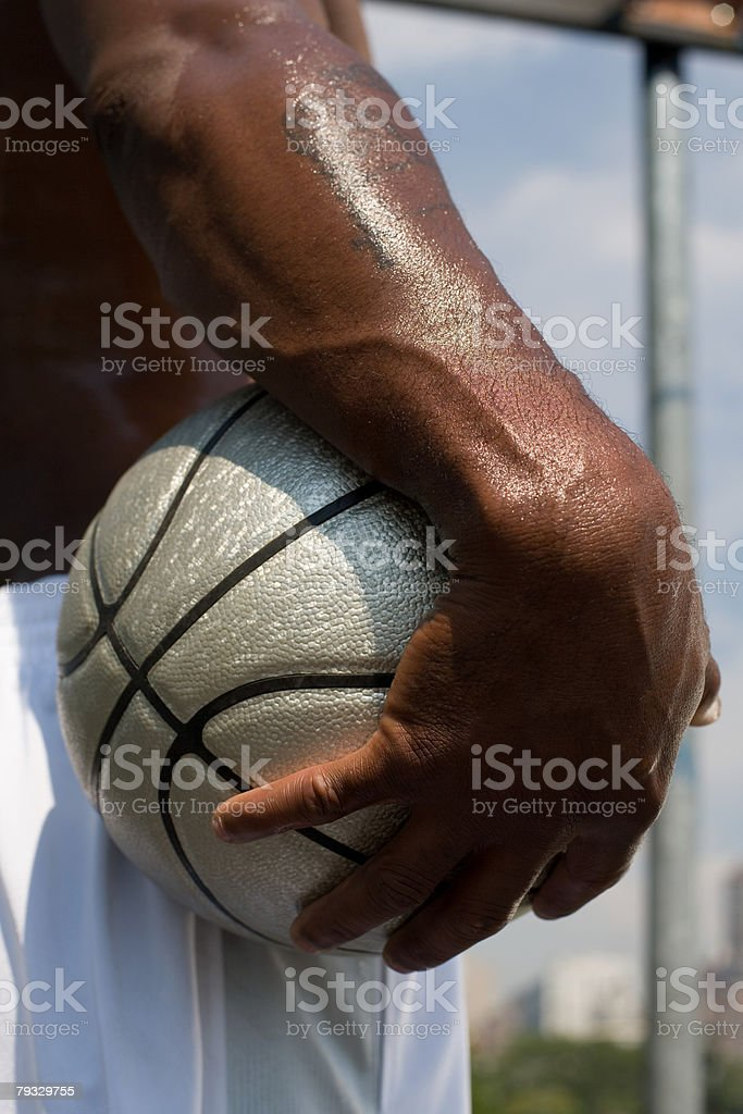 A man holding a basketball stock photo