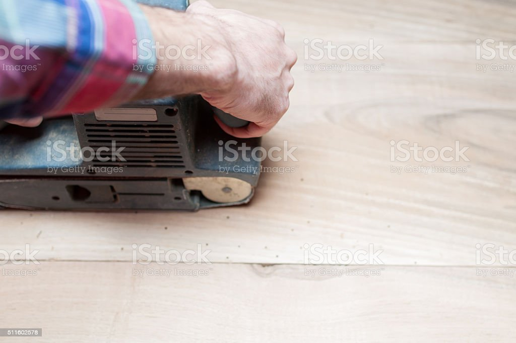 Man holding a belt sander stock photo