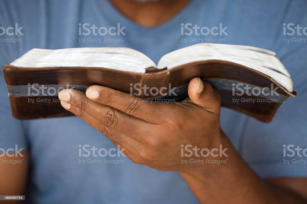 Man holding a Bible stock photo