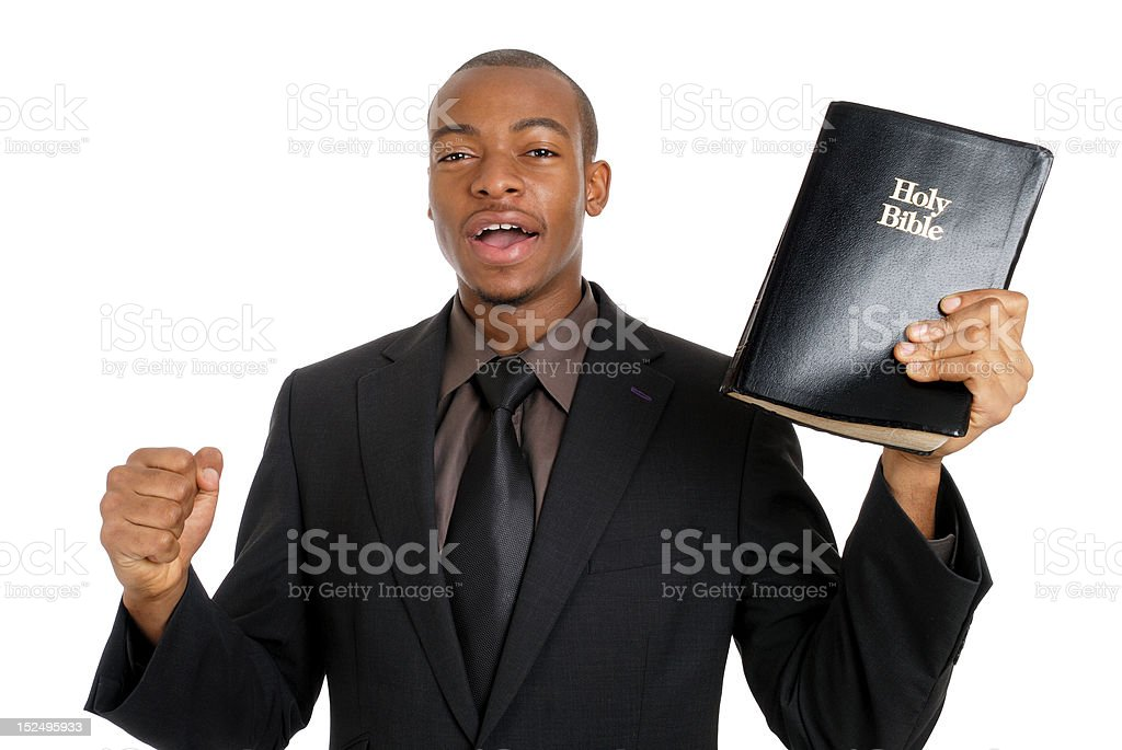 Man holding a bible preaching the gospel stock photo