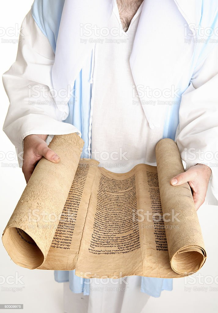 Man holding a bible scroll on gevil parchment stock photo
