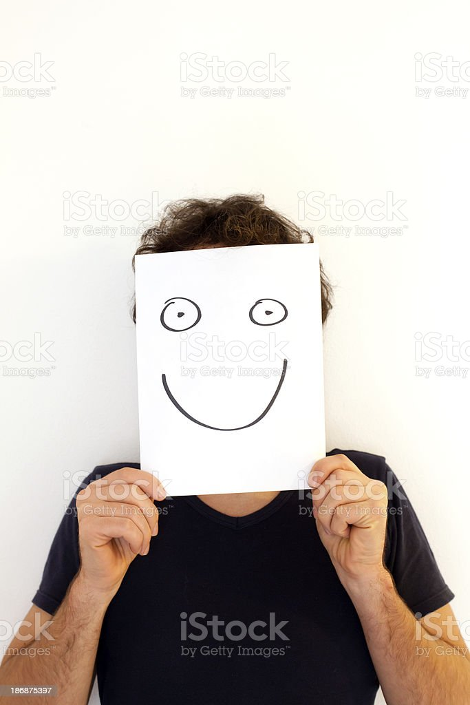 Man Holding a Blank Paper with Smiley Face stock photo