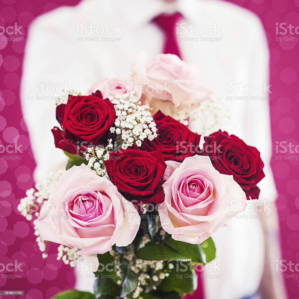 Man holding a bouquet of roses royalty-free stock photo