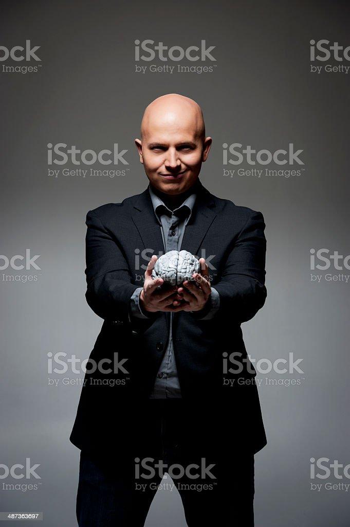 Man holding a brain royalty-free stock photo