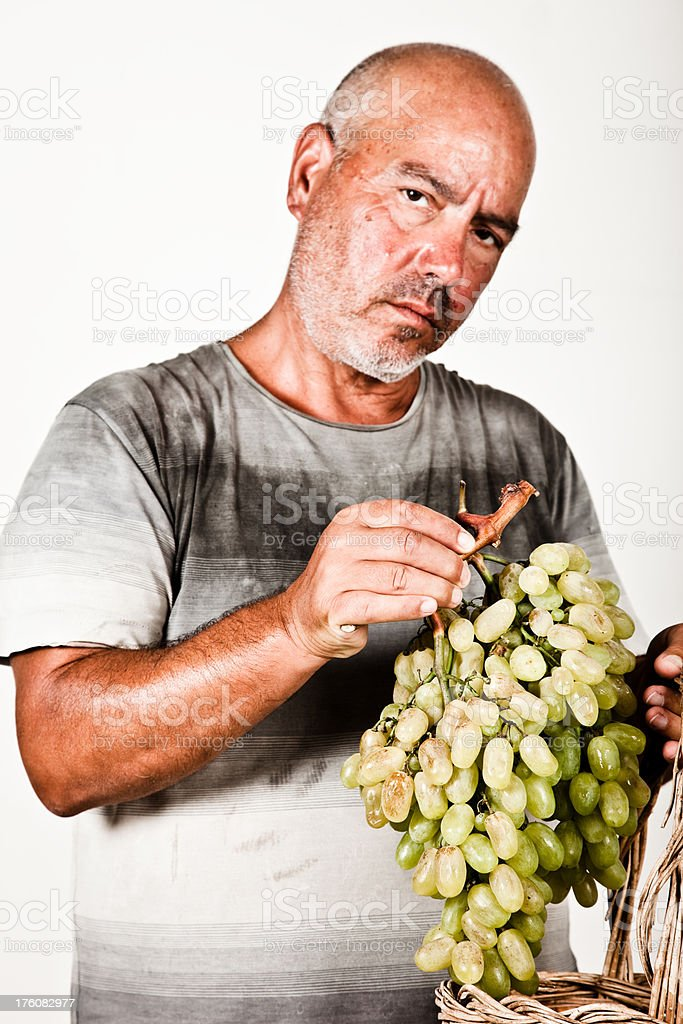 Man holding a bunch of grapes stock photo