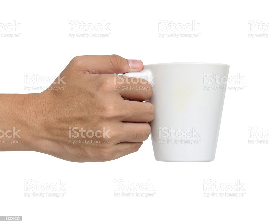 Man holding a ceramic cup isolated over white background stock photo