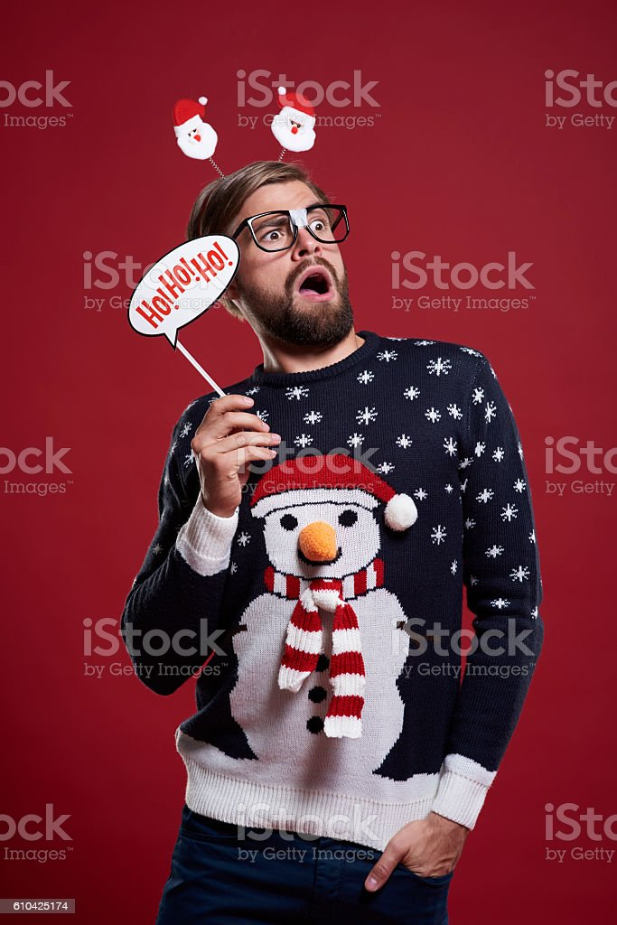 Man holding a Christmas mask stock photo