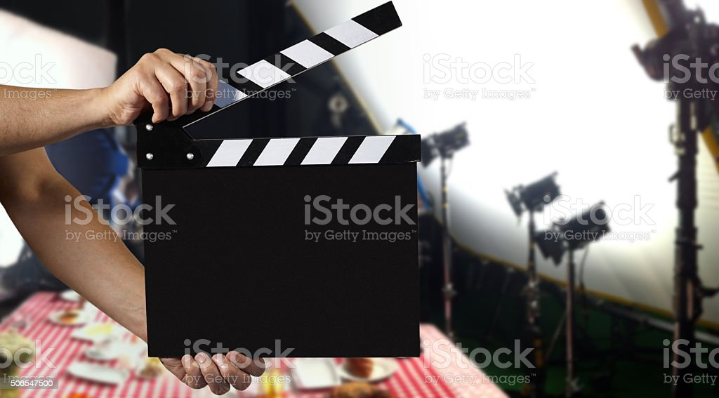 Man holding a clapper stock photo