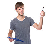 Man holding a clipboard and pen