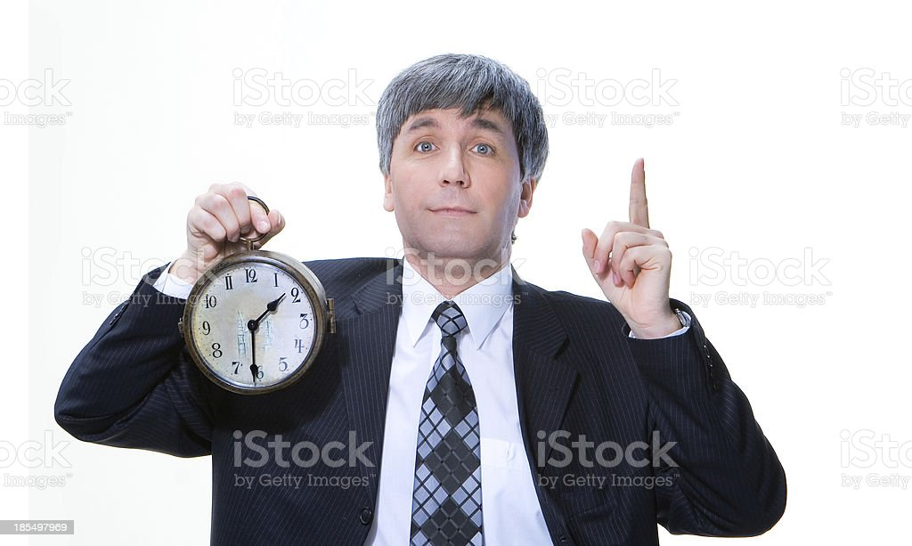 man holding a clock royalty-free stock photo
