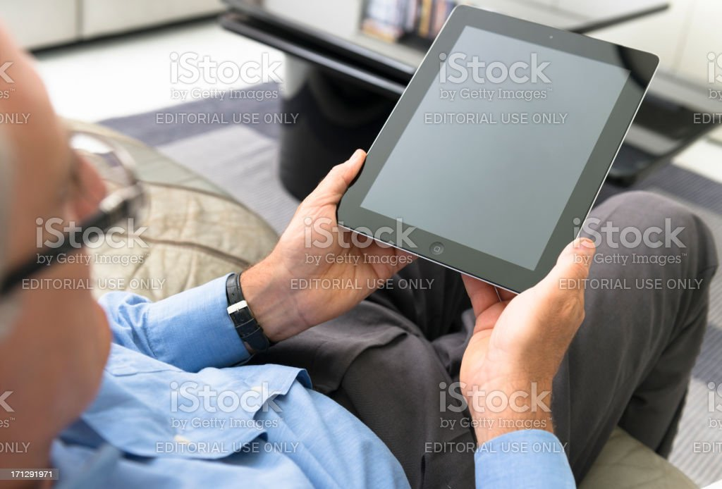 Man holding a contemporary digital tablet at home royalty-free stock photo