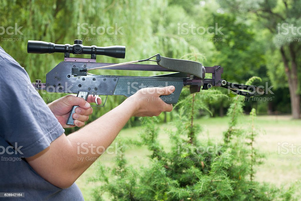 Man holding a crossbow stock photo