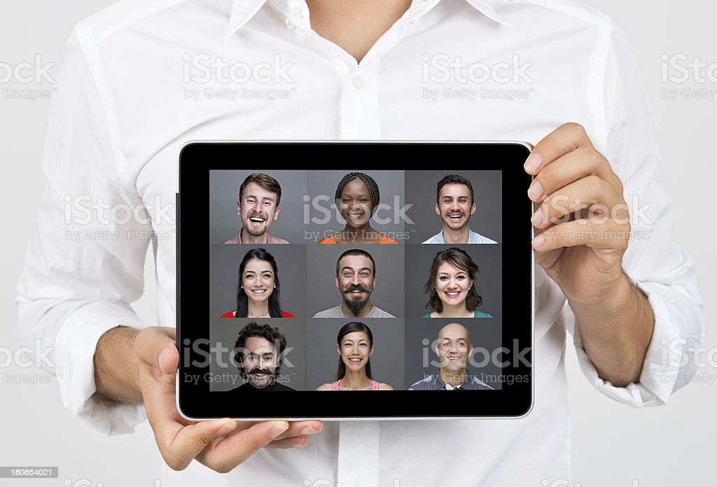Man holding a digital tablet with people images royalty-free stock photo