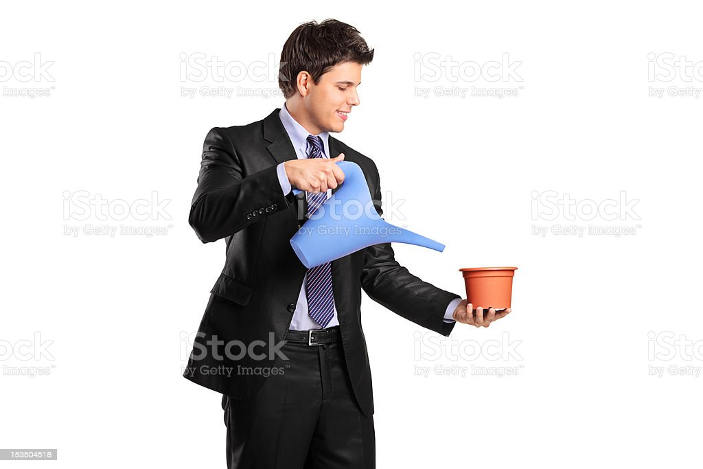 Man holding a flower pot and watering can royalty-free stock photo