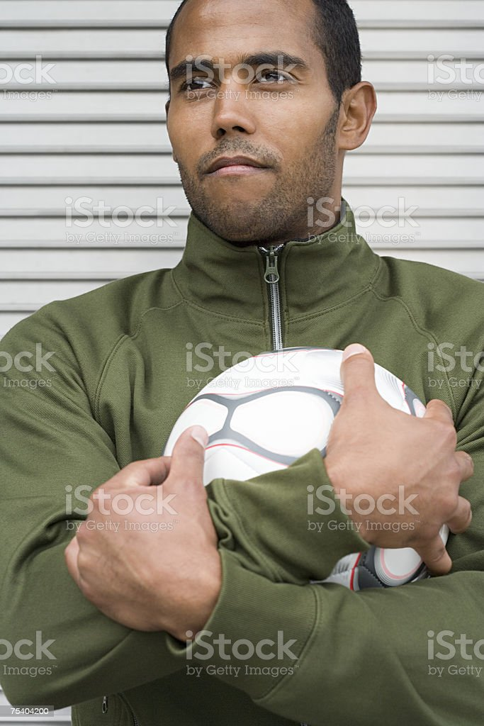 Man holding a football royalty-free stock photo